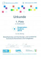 """Urkunde über den 1. Platz des Gütersloher Modellbahn-Projekts im Wettbewerb """"Kooperation. Konkret"""" der Medienberatung NRW"""